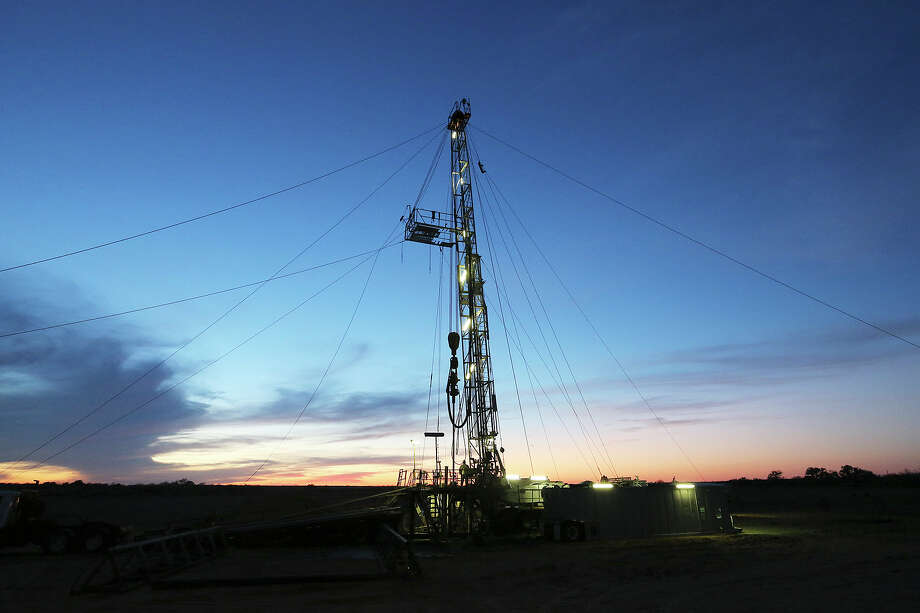 The sun sets on a drilling rig in Frio County, Sunday, Jan. 20, 2013. The drilling is funded by third generation wildcatter, Harvey Howell of San Antonio. Photo: Jerry Lara, San Antonio Express-News / © 2013 San Antonio Express-News