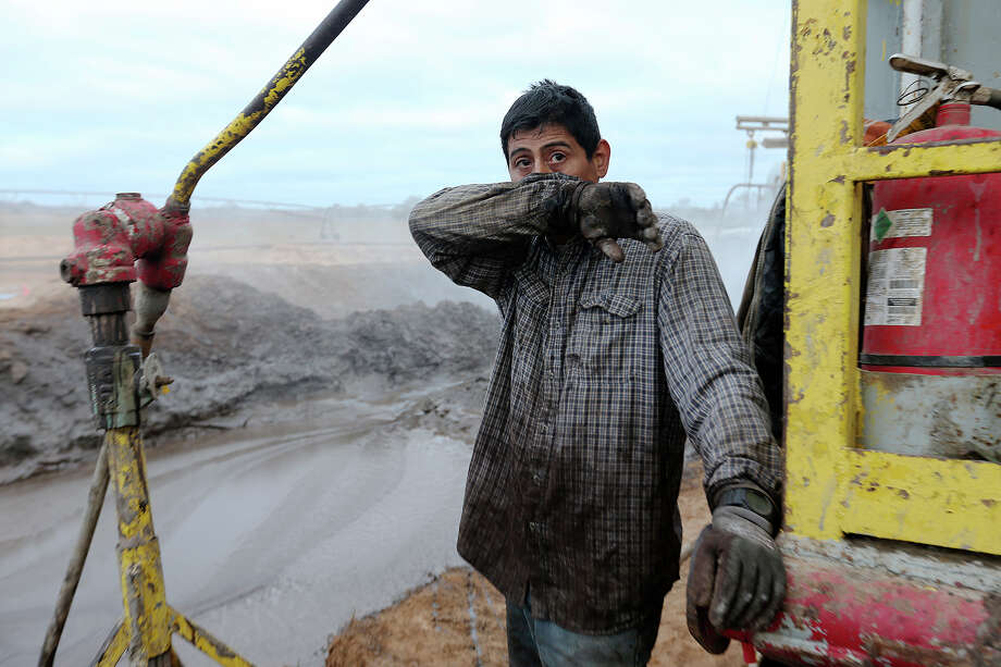Derrickman Nestor Lerma, Jr. 36, of Freer, takes a quick break while mixing mud at a drilling site in Frio County, Monday, Jan. 21, 2013. The mud is used to build up the walls of the hole they are drilling. Photo: Jerry Lara, San Antonio Express-News / © 2013 San Antonio Express-News