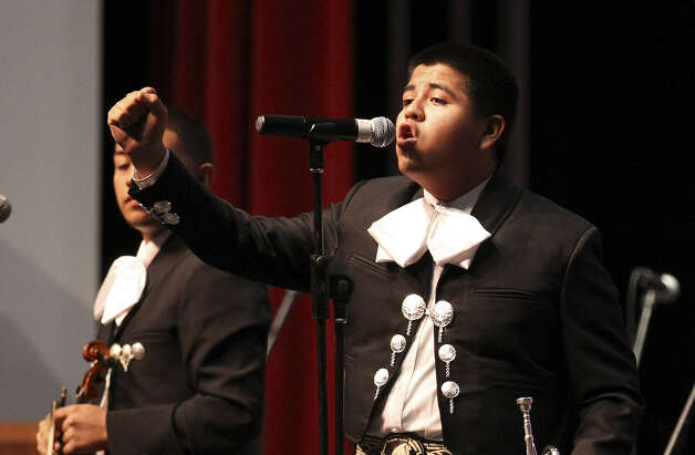 "Brackenridge freshman Manuel Valero, 15, utilizes his voice as well as his trumpet. ""We've had so many obstacles just to get this far,"" said John Nieto, the school's mariachi director. ""I couldn't be prouder of them."""