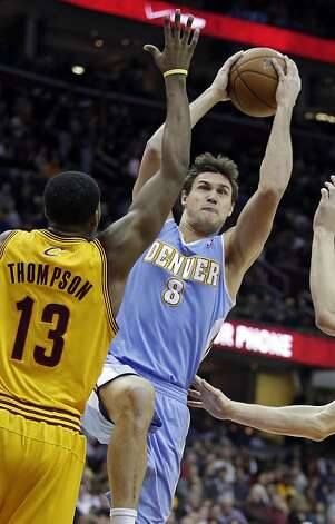 Denver's Danilo Gallinari, who finished with 19 points, shoots over Cavaliers' Tristan Thompson in Cleveland. Photo: Mark Duncan, Associated Press