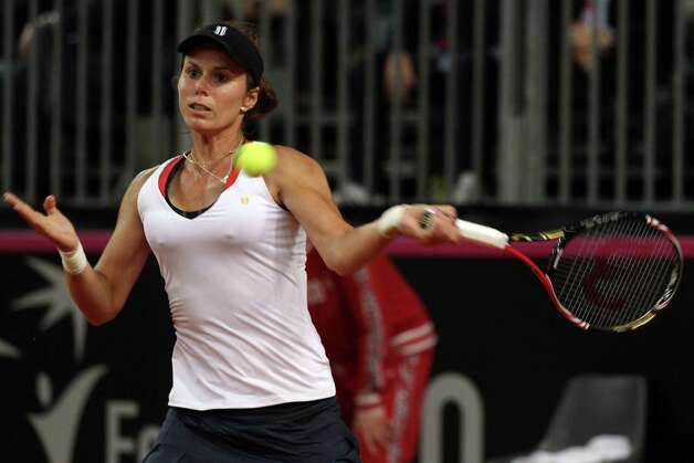 United States' Varvara Lepchenko returns the ball to Italy's Roberta Vinci during a World Group first round Fed Cup tennis match at the 105 stadium in Rimini, Saturday, Feb. 9, 2013. (AP Photo/Felice Calabro') Photo: Felice Calabro' / AP