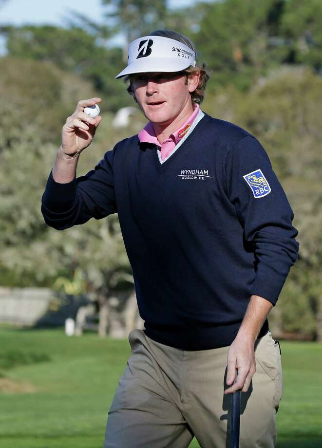 Brandt Snedeker holds up his ball after making a birdie on the second green of the Pebble Beach Golf Links during the third round of the AT&T Pebble Beach Pro-Am golf tournament  Saturday, Feb. 9, 2013 in Pebble Beach, Calif. Snedeker shot a 4-under-par 68. (AP Photo/Eric Risberg) Photo: Eric Risberg