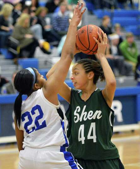 Shaker's #22 Lyric Artis, left, and Shen's #44  Sydney Brown during Saturday's game at Shaker High i