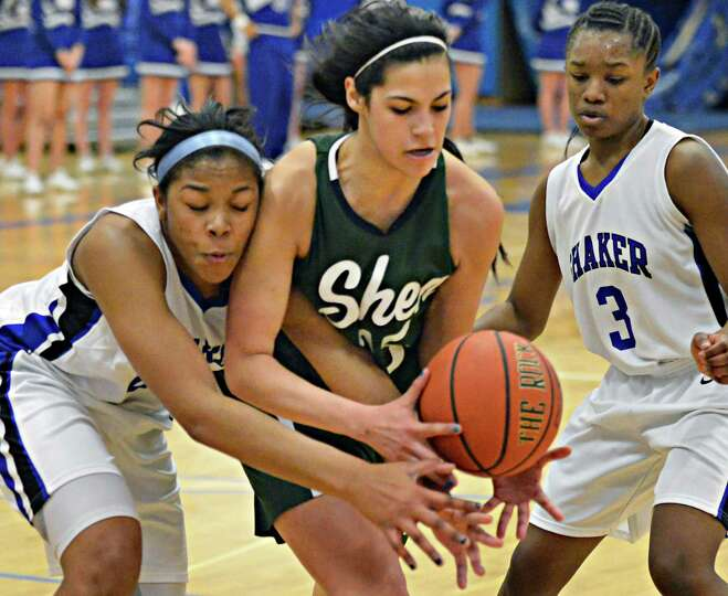 Shen's #15 Alyssia Marsal, center, is double teamed by Shaker's #22 Lyric Artis, left, and  #3 Adrie