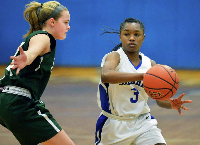 Shen's #24 Ashley Acker, left, and Shaker's #3 Adriene Gambles during Saturday's game at Shaker High
