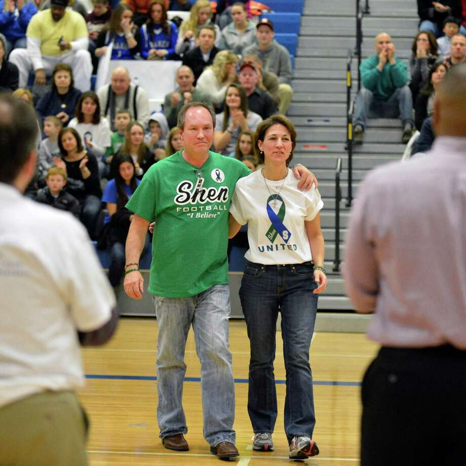 Parents of accident victim Chris Stewart, Regina and Mike Stewart, during a ceremony honoring survivors Bailey Wind and Matt Hardy before Saturday's Shen vs. Shaker basketball game at Shaker High in Colonie Fe. 9, 2013.  (John Carl D'Annibale / Times Union) Photo: John Carl D'Annibale / 10021092A