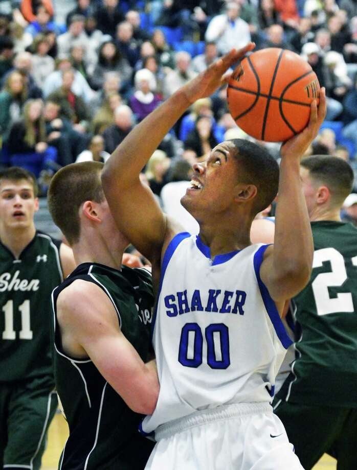 Shaker's #00 Malik Dare battles Shen defenders during Saturday's game at Shaker High in Colonie Feb. 9, 2013.  (John Carl D'Annibale / Times Union) Photo: John Carl D'Annibale / 10021092A