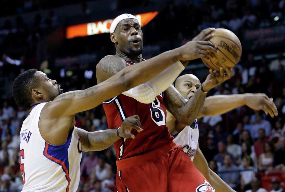 Miami Heat's LeBron James (6) is fouled as he goes to the basket by Los Angeles Clippers' DeAndre Jordan, left, during the first half of an NBA basketball game in Miami, Friday, Feb. 8, 2013. (AP Photo/Alan Diaz) Photo: Alan Diaz