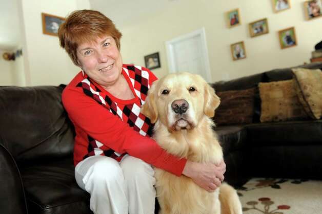 Kathleen McLaughlin-Wager with her champion golden retriever Highmark's Sweet Sir Galahad, better known as Finley, on Tuesday, Feb. 5, 2013, in Guilderland, N.Y. Finley will compete in the Westminster Dog Show. (Cindy Schultz / Times Union) Photo: Cindy Schultz / 10020884A