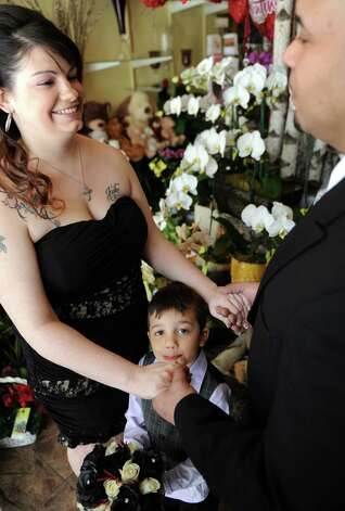 Justin Ayala looks on as his mother, Amy Troiano, marries Omar Velez at Stamford Florist on Saturday, February 9, 2013. Photo: Lindsay Perry / Stamford Advocate