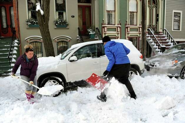 Erica Cubello, left, receives help from John DeBois in digging out her car in Center Square after a snowstorm on Saturday, Feb. 9, 2013, in Albany, N.Y. (Cindy Schultz / Times Union) Photo: Cindy Schultz / 00021098A