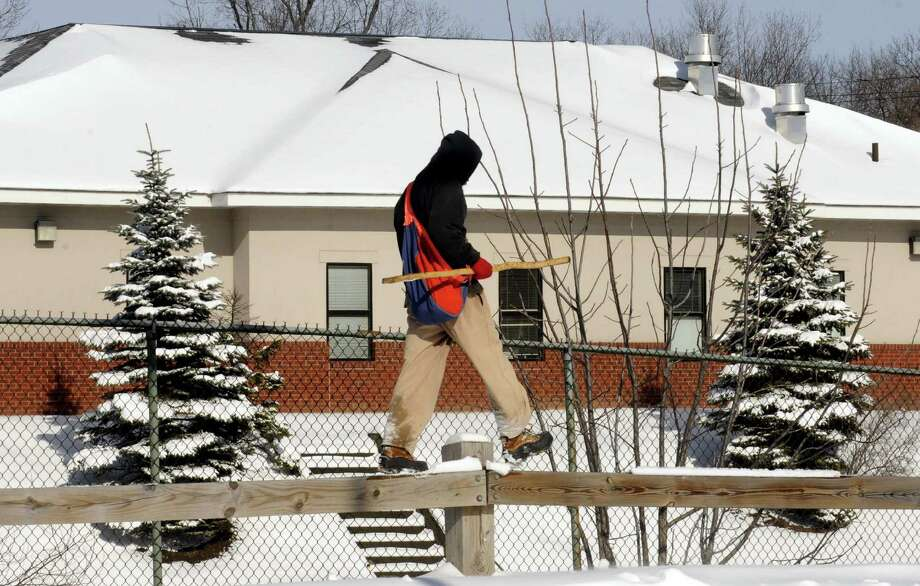 A  man, who would not give name, navigates a guard rail in the lot of Troy Plaza on Saturday Feb. 9, 2013 in Troy, N.Y. .(Michael P. Farrell/Times Union) Photo: Michael P. Farrell