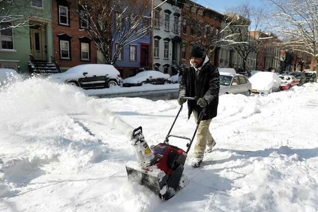 Eric Lee snow blows the sidewalk at First Israel AME Church in Center Square after a snowstorm on Saturday, Feb. 9, 2013, in Albany, N.Y. (Cindy Schultz / Times Union) Photo: Cindy Schultz / 00021098A