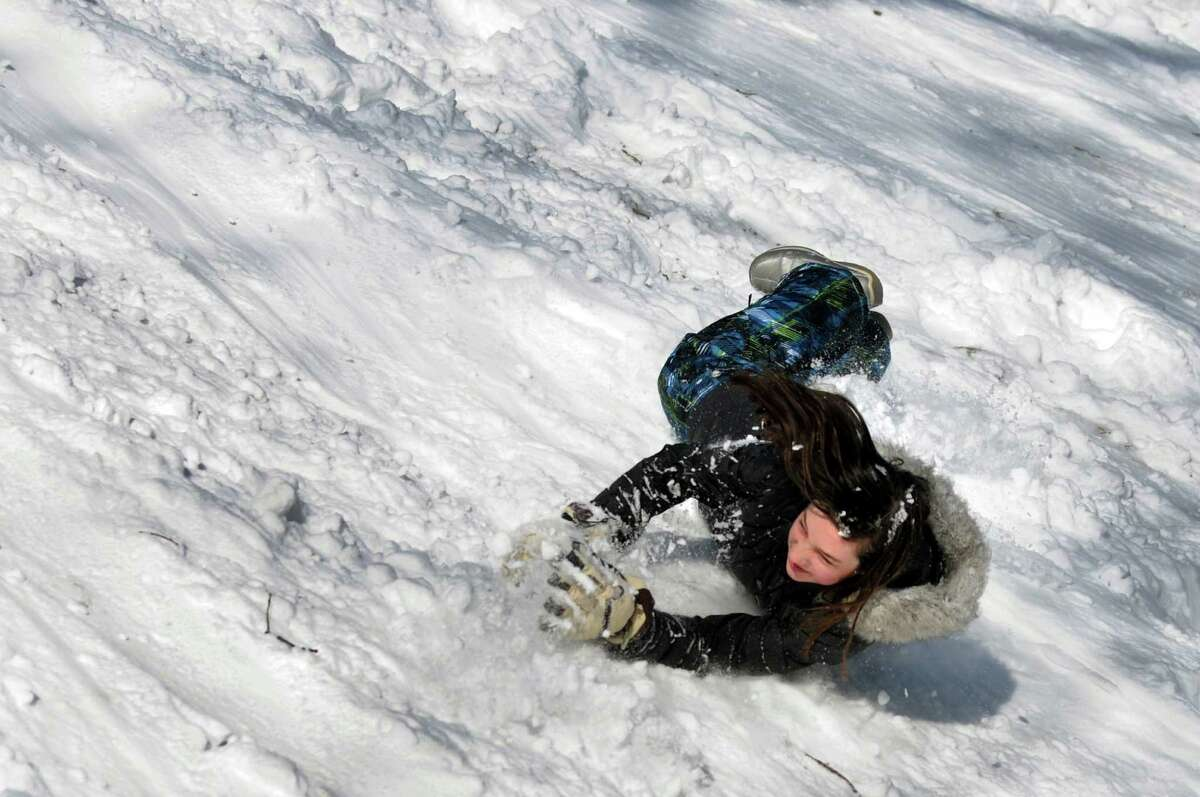 Thia Fowler, 12, slides and rolls down a hill after a snowstorm on Saturday, Feb. 9, 2013, at Washington Park in Albany, N.Y. (Cindy Schultz / Times Union)