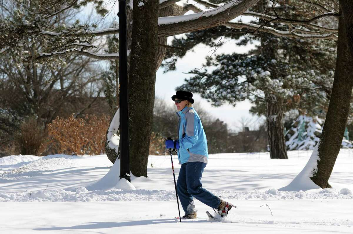 Christine Haile of Albany snowshoes through the fresh snow on Saturday, Feb. 9, 2013, at Washington Park in Albany, N.Y. (Cindy Schultz / Times Union)