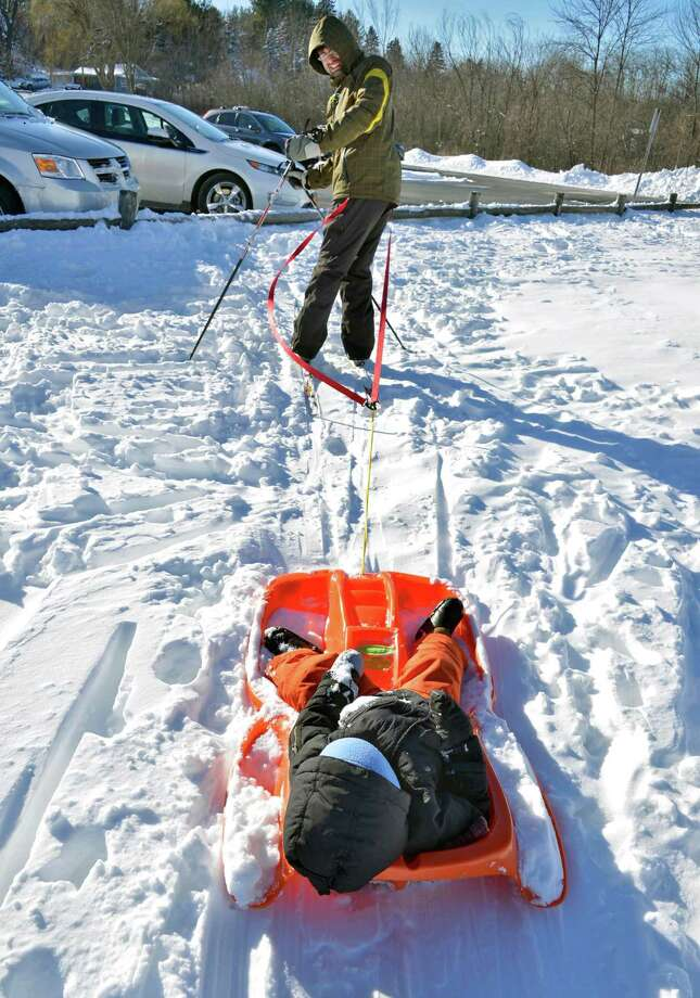 Roman Yukilevich of Niskayuna pulls son Noah,3, behind him as he cross country skis along the bike path in Niskayuna Saturday Feb. 9, 2013.  (John Carl D'Annibale / Times Union) Photo: John Carl D'Annibale / 00021098A