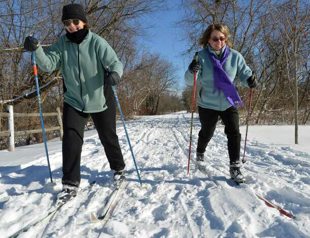 Margaret Novak, left, and Marcia Gangemi, both of Schenectady, cross country ski along the bike path in Niskayuna Saturday Feb. 9, 2013.  (John Carl D'Annibale / Times Union) Photo: John Carl D'Annibale / 00021098A