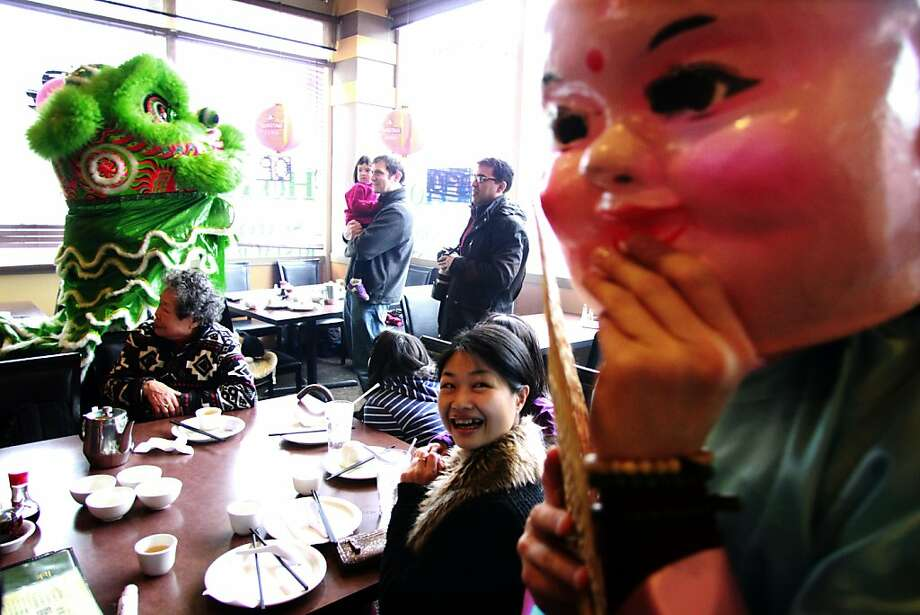 Members of the Mak Fai Kung Fu Club surprise diners while dressed as a dragon and the Buddha in the Ho Ho Seafood Restaurant during a Lunar New Year celebration, Saturday, Feb. 9, 2013, in the Chinatown section of Seattle.  Photo: Alan Berner, Associated Press