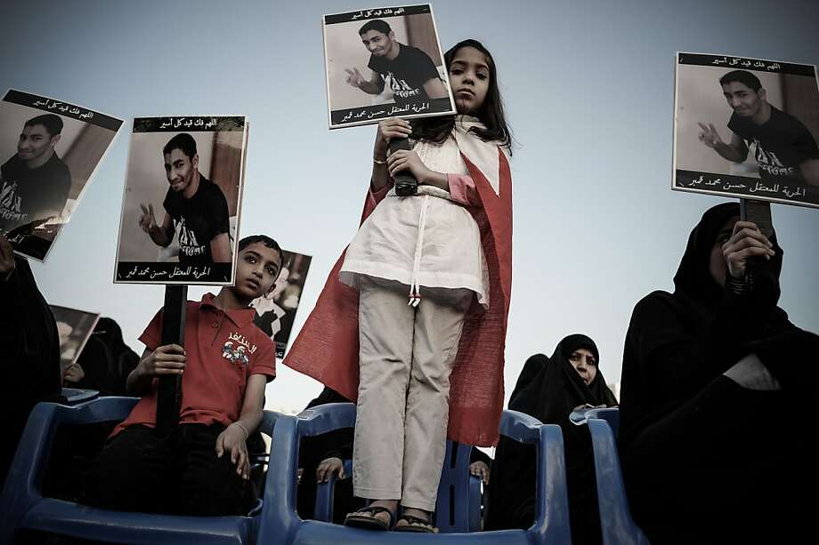 A Bahraini girl holds up a picture of her relative detainee during an anti-government rally to demand reforms on February 9, 2013 in the village of Al Muqsha, west of the Bahraini capital Manama. Bahrain's national dialogue is set to resume on February 10, in an atmosphere of mutual mistrust between government and the opposition ahead of the second anniversary of a Shiite-led uprising that shook the Gulf kingdom.  Photo: Mohammed Al-shaikh, AFP/Getty Images