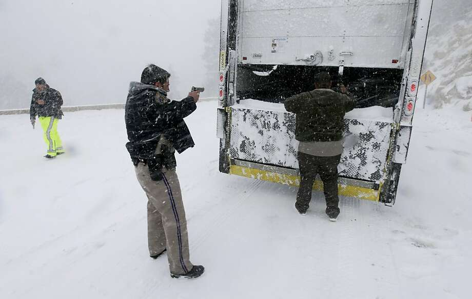 Members on the California Highway Patrol search a truck for Christopher Dorner, a former Los Angeles police officer accused of carrying out a killing spree because he felt he was unfairly fired from his job, Friday, Feb. 8, 2013, in Big Bear Lake, Calif. (AP Photo/Chris Carlson) Photo: Chris Carlson, Associated Press