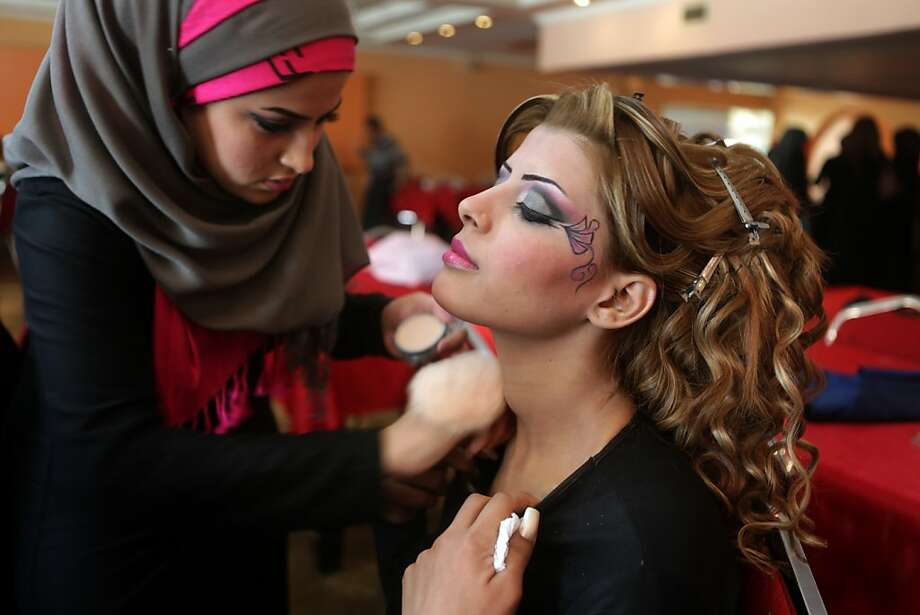 An Iraqi model is made up backstage before a show during a hairdressers and make up artists festival on February 9, 2013 in Baghdad. It is the first time that this kind of festival takes place in the Iraqi capital since 1999. Photo: Patrick Baz, AFP/Getty Images