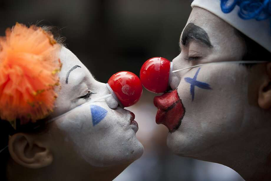"A couple dressed as clowns participate in the ""Cordao da Bola Preta"" street carnival parade in Rio de Janeiro, Brazil, Saturday, Feb. 9, 2013. According to Rio's tourism office, Rio's street Carnival this year will consist of 492 block parties, attended by an estimated five million Carnival enthusiasts. Photo: Felipe Dana, Associated Press"