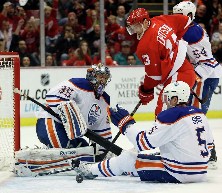 Detroit Red Wings center Pavel Datsyuk (13), of Russia, watches the puck bounce out of the net after scoring against Edmonton Oilers goalie Nikolai Khabibulin (35), of Russia, and defenseman Ladislav Smid (5), of Czechoslovakia, in the second period of an NHL hockey game Saturday, Feb. 9, 2013, in Detroit. (AP Photo/Duane Burleson) Photo: Duane Burleson