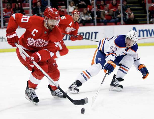 Detroit Red Wings center Henrik Zetterberg (40), of Sweden, tries to keep the puck away from Edmonton Oilers center Ryan Nugent-Hopkins (93) during the first period of an NHL hockey game Saturday, Feb. 9, 2013, in Detroit. (AP Photo/Duane Burleson) Photo: Duane Burleson