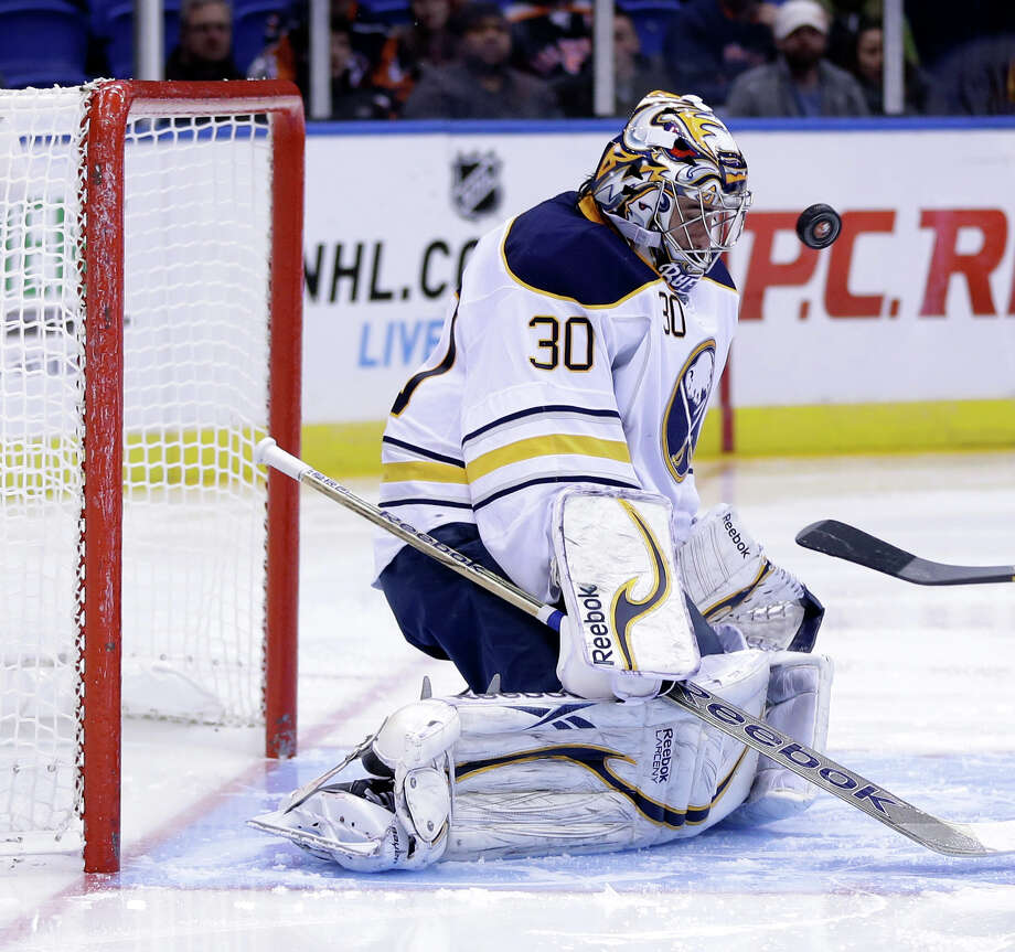 Buffalo Sabres goalie Ryan Miller makes a save during the second period of the NHL hockey game against the New York Islanders Saturday, Feb. 9, 2013, in Uniondale, N.Y. (AP Photo/Seth Wenig) Photo: Seth Wenig