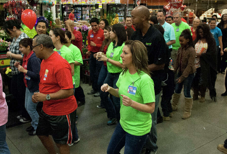 Former San Antonio Spur Bruce Bowen, H-E-B officers, employees and customers break out in dance to the the song Cupid Shuffle at the H-E-B on 5910 Babcock Road, Saturday, Feb. 9, 2013. The dance break is in support of American Heart Month. Photo: Steve Faulisi, San Antonio Express-News / ©2013 San Antonio Express-News