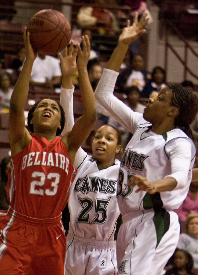 Bellaire's A.J. Alix (left) shoots the ball past Hightower's Azalea Hall (center) and Tyler Gilbert during the first quarter of the Class 5A-Region III girl's basketball championship game at Alidine ISD's M. O. Campbell Center Saturday, Feb. 27, 2010, in Houston. ( James Nielsen / Chronicle ) Photo: James Nielsen, Staff / Houston Chronicle