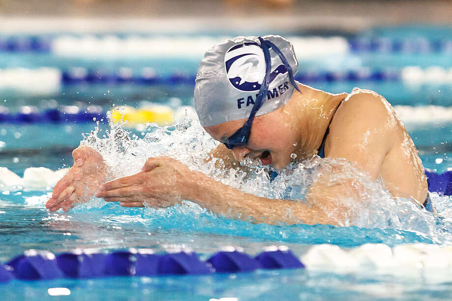 Boerne Champion's Lexi Farmer competes in the girls 100-yard breaststroke during the Region VIII-4A meet Saturday at Block Aquatic Center. Farmer set a meet record with a time of 1:06.97. She also won the 200 IM. Photo: Marvin Pfeiffer / San Antonio Express-News