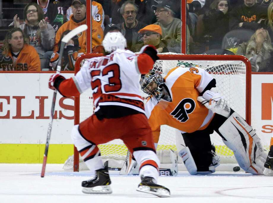 Carolina Hurricanes' Jeff Skinner, left, reacts after scoring a goal past Philadelphia Flyers' Ilya Bryzgalov, of Russia, during the second period of an NHL hockey game, Saturday, Feb. 9, 2013, in Philadelphia. (AP Photo/Matt Slocum) Photo: Matt Slocum