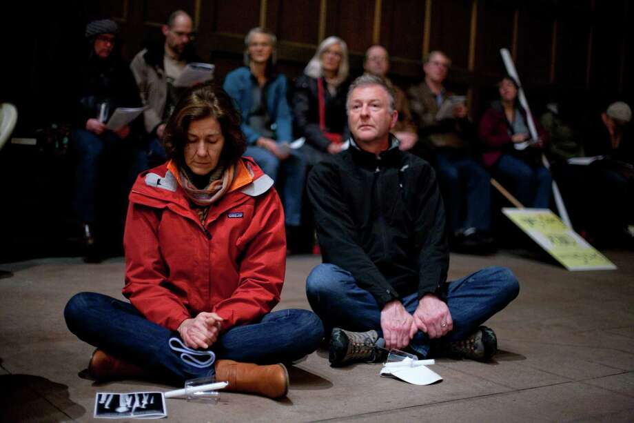 Participants listen to a prayer at St. Marks Cathedral during an interfaith vigil and march against gun violence. Photo: JOSHUA TRUJILLO, SEATTLEPI.COM / SEATTLEPI.COM