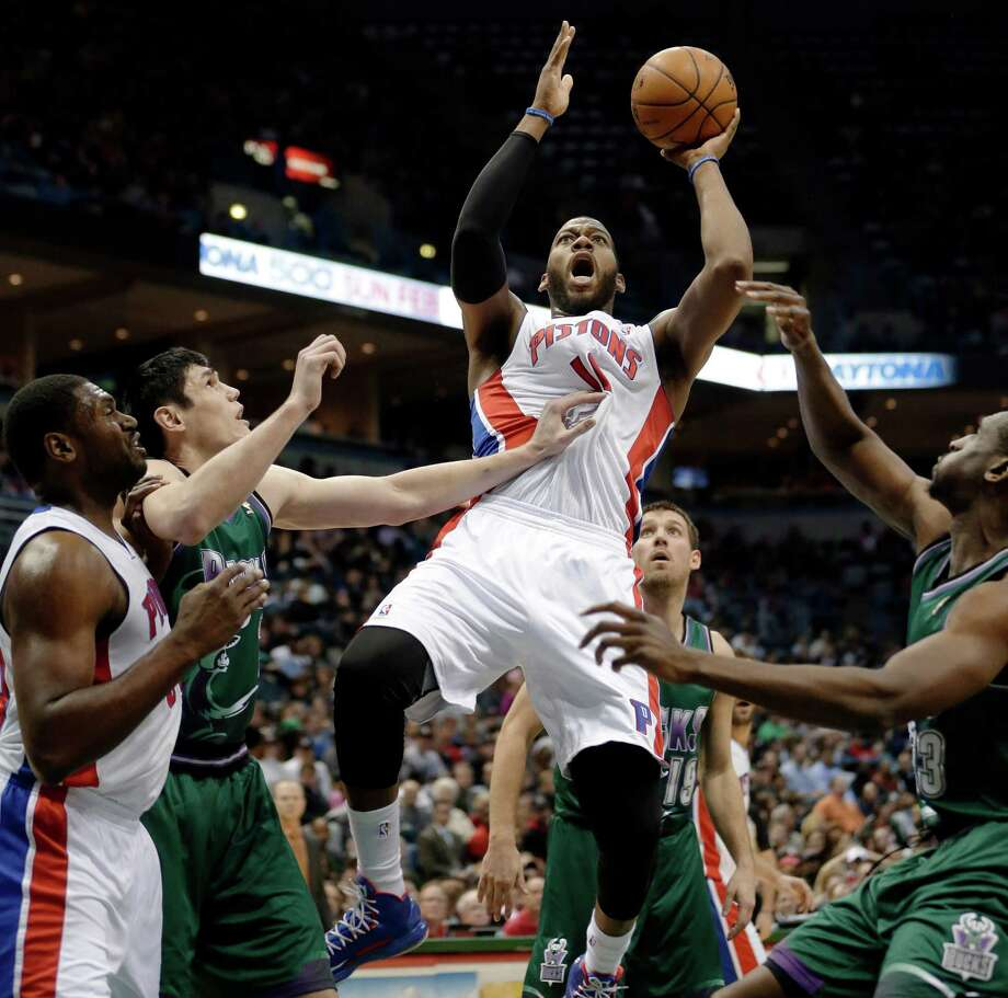Greg Monroe, center, and the Pistons used a 3-pointer by Charlie Villanueva with 9.7 seconds left to break a tie and lift Detroit over Milwaukee on Saturday. Photo: Aaron Gash, FRE / AP