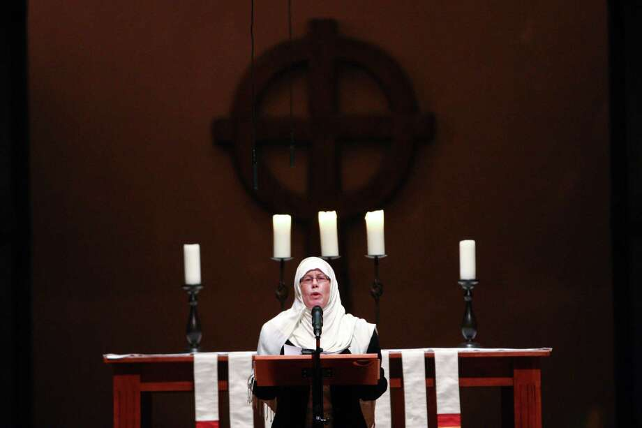Janice Tufte, a member of the Muslim community, speaks during an interfaith vigil and march against gun violence at St. Marks Episcopal Cathedral. Photo: JOSHUA TRUJILLO, SEATTLEPI.COM / SEATTLEPI.COM