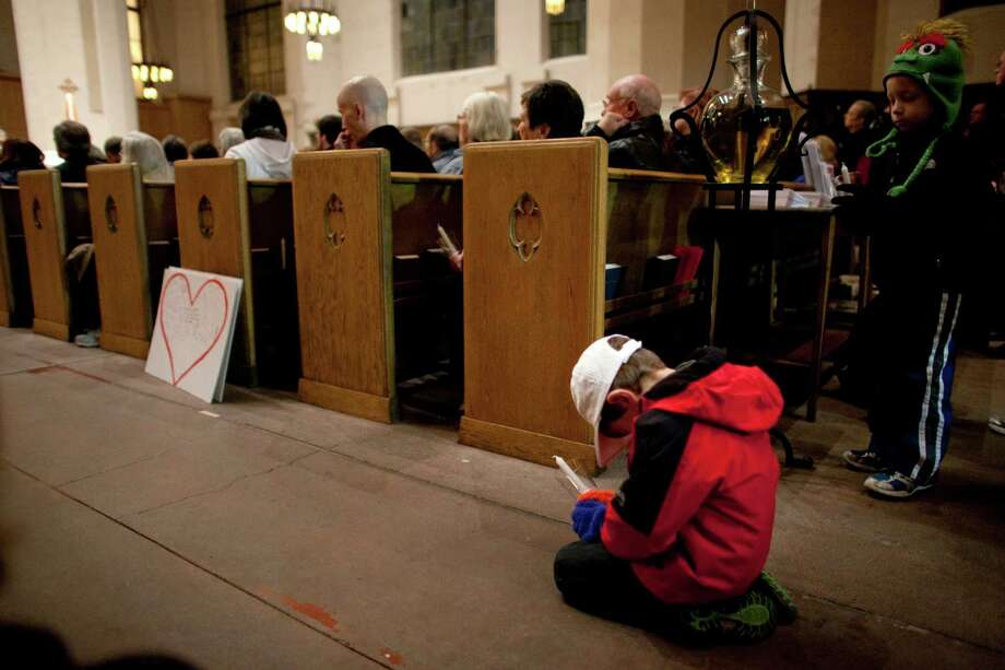 Jackson Hatch, 5, bows during an interfaith vigil and march against gun violence at St. Marks Episcopal Cathedral. Photo: JOSHUA TRUJILLO, SEATTLEPI.COM / SEATTLEPI.COM