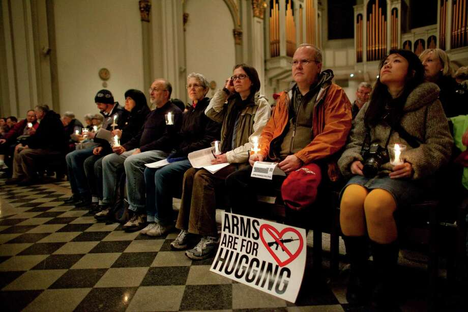 People listen to a speaker in St. James Cathedral during an interfaith vigil and march against gun violence. Photo: JOSHUA TRUJILLO, SEATTLEPI.COM / SEATTLEPI.COM
