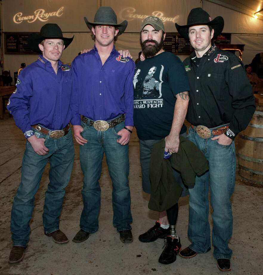 Crown Royal Riders Steve Woolsey (from left), Tilden Hooper, 1st Sgt. Mitch Melott, and Crown Royal Rider Wesley Silcox pose during the Crown Royal CAMO Care Package event, Saturday, Feb. 9, 2013, at the San Antonio Stock Show and Rodeo. Photo: Darren Abate, Associated Press / AP Images