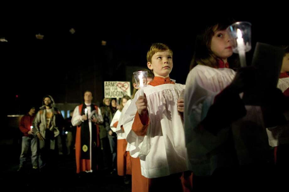Children lead marchers during an interfaith vigil and march against gun violence. Photo: JOSHUA TRUJILLO, SEATTLEPI.COM / SEATTLEPI.COM