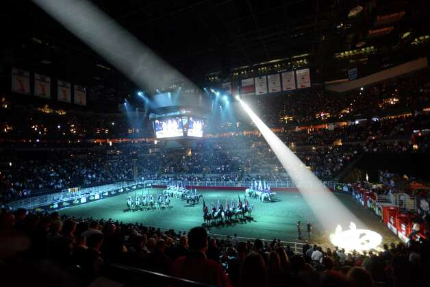 The colors are presented during the third day of Stock Show & Rodeo on Saturday, Feb. 9, 2013. Photo: Billy Calzada, San Antonio Express-News / San Antonio Express-News