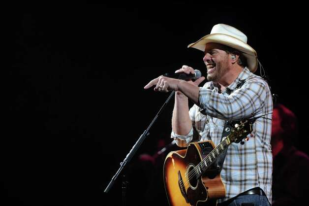 Country music performer Toby Keith sings during the third day of Stock Show & Rodeo on Saturday, Feb. 9, 2013. Photo: Billy Calzada, San Antonio Express-News / San Antonio Express-News