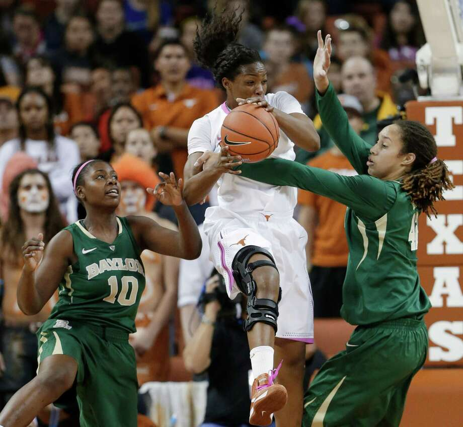 Baylor's Destiny Williams, left, and Brittney Griner put the squeeze on UT's Nneka Enemkpali. Photo: Eric Gay, STF / AP