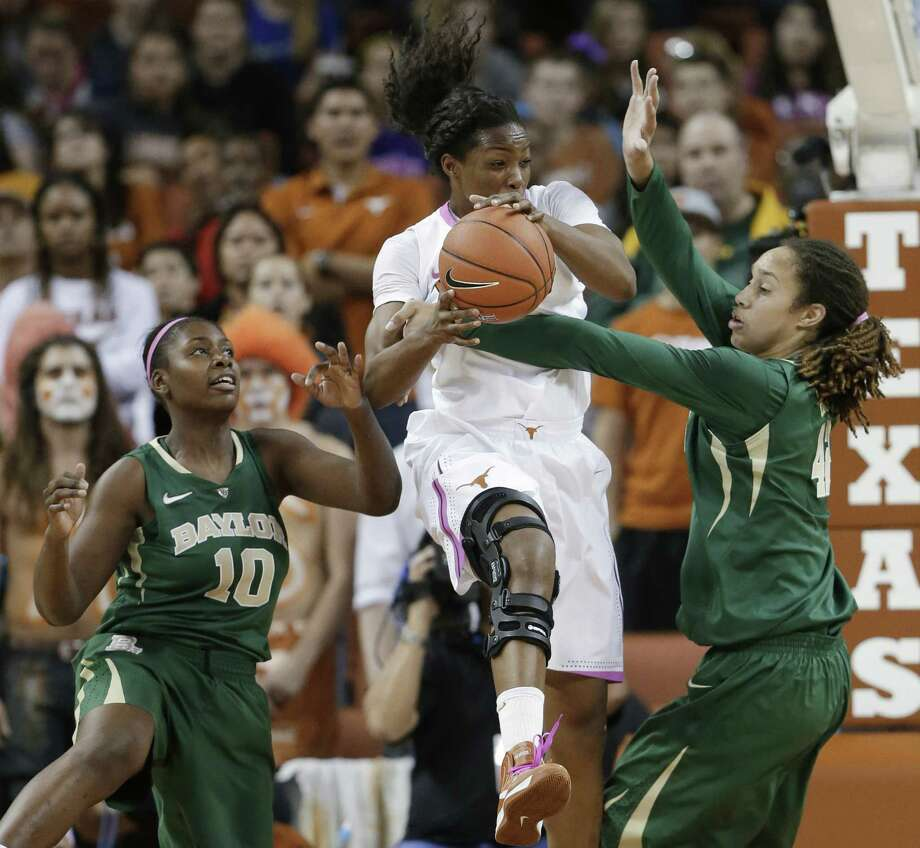 Baylor's Brittney Griner, who had 14 points and eight blocks, and Destiny Williams (left) pressure Texas' Nneka Enemkpali in the first half. Photo: Eric Gay / Associated Press