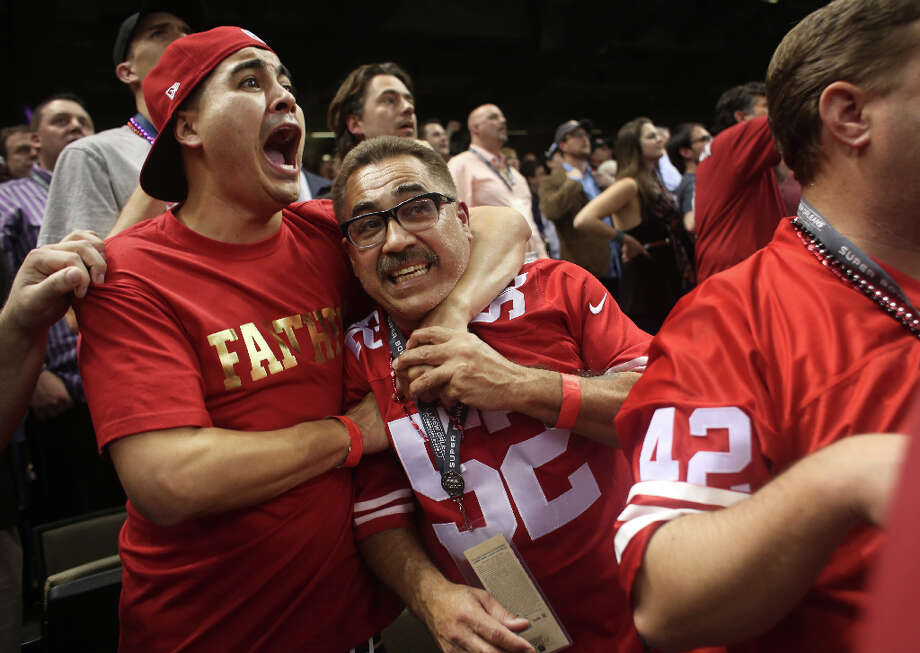 During late game momentum for the 49ers, Juan Trujillo and his father John Trujillo, of San Francisco, hug at Super Bowl XLVII at the Mercedes-Benz Superdome on Sunday February 3, 2013, New Orleans, La. Photo: Mike Kepka, The Chronicle / ONLINE_YES