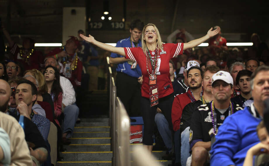 Lisa Fine-Muth cheers during a 1st down for the Niners in the Super Bowl XLVII between the San Francisco 49ers and the Baltimore Ravens at the Mercedes-Benz Superdome on Sunday February 3, 2013, New Orleans, La. Photo: Mike Kepka, The Chronicle / ONLINE_YES