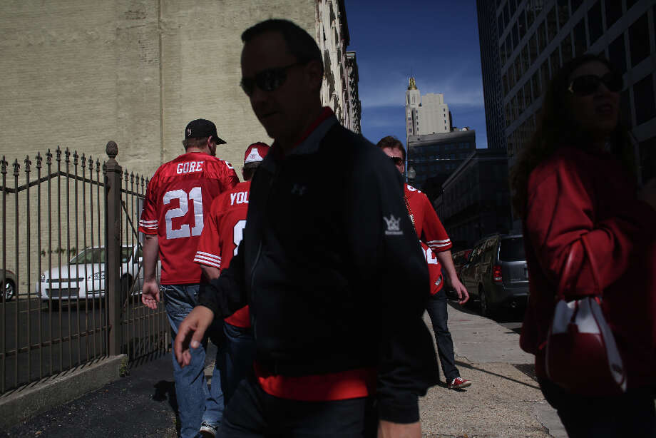 Niners fans make their way to Super Bowl XLVII between the San Francisco 49ers and the Baltimore Ravens at the Mercedes-Benz Superdome on Sunday February 3, 2013, New Orleans, La. Photo: Mike Kepka, The Chronicle / ONLINE_YES