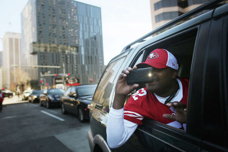 Benny Paige make a picture from his care while heading to Super Bowl XLVII between the San Francisco 49ers and the Baltimore Ravens at the Mercedes-Benz Superdome on Sunday February 3, 2013, New Orleans, La. Photo: Mike Kepka, The Chronicle / ONLINE_YES