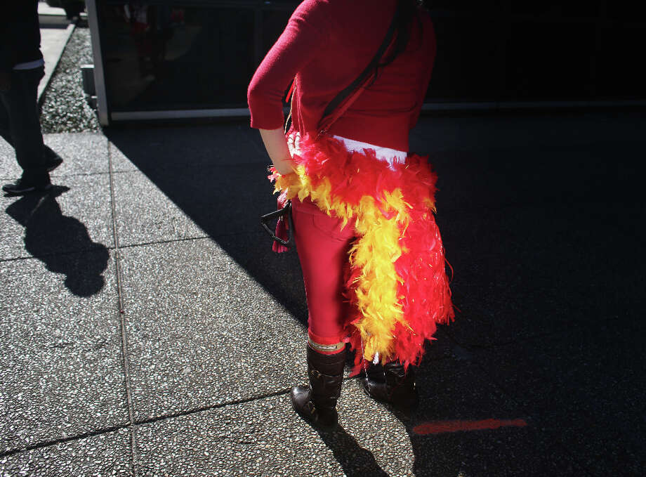Wearing a homemade feather skirt, Eren Sandoval, of Fremont, Calif., stops on  her way to Super Bowl XLVII between the San Francisco 49ers and the Baltimore Ravens at the Mercedes-Benz Superdome on Sunday February 3, 2013, New Orleans, La. Photo: Mike Kepka, The Chronicle / ONLINE_YES