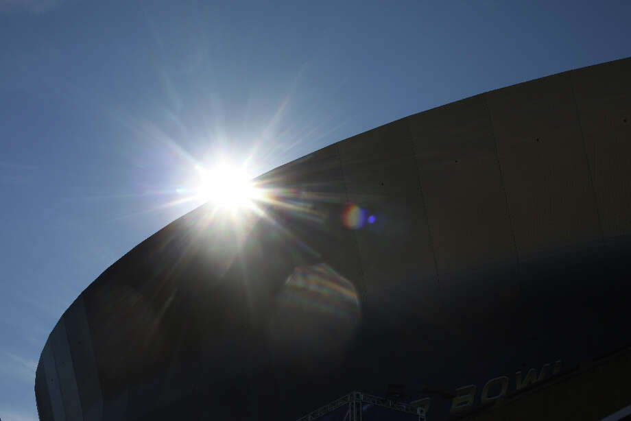 The morning sun makes it's way over the Mercedes-Benz Superdome hours before the start of Super Bowl XLVII between the San Francisco 49ers and the Baltimore Ravens at the on Sunday February 3, 2013, New Orleans, La. Photo: Mike Kepka, The Chronicle / ONLINE_YES